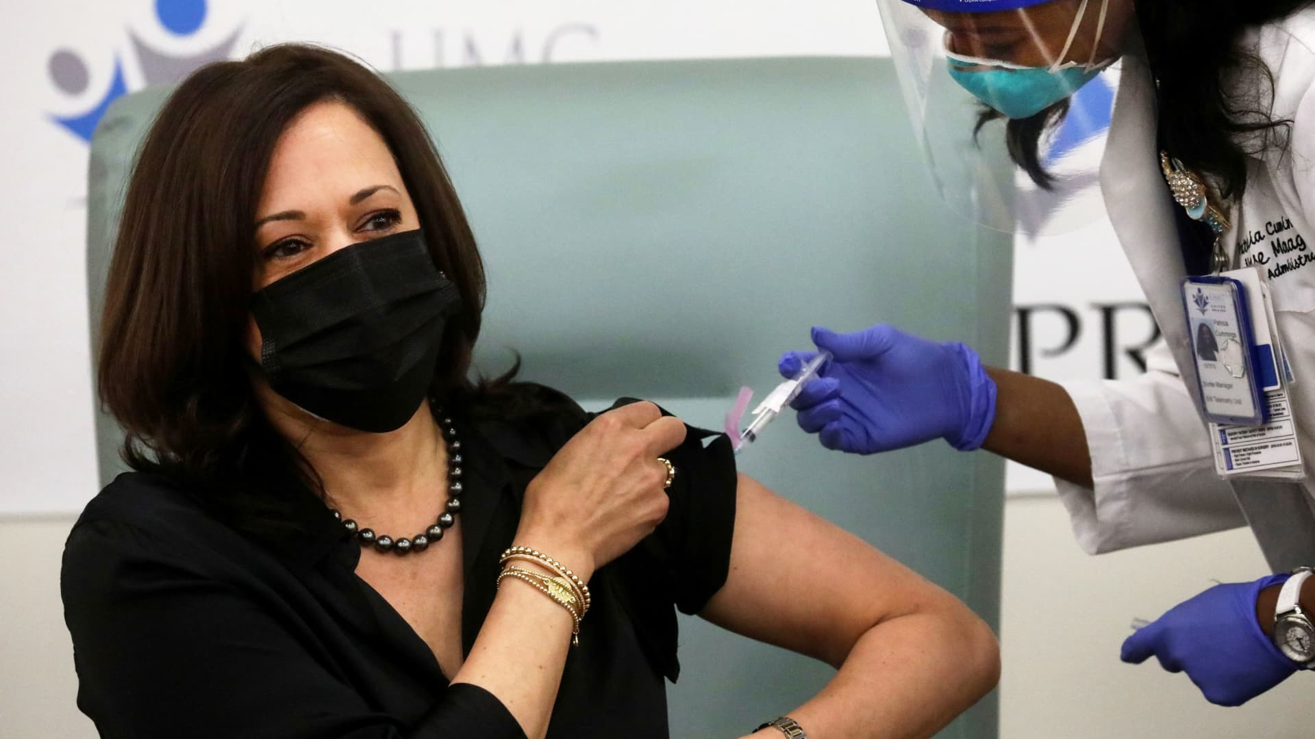U.S. Vice President-elect Kamala Harris receives a dose of the Moderna COVID-19 vaccine at United Medical Center in Washington, December 29, 2020.