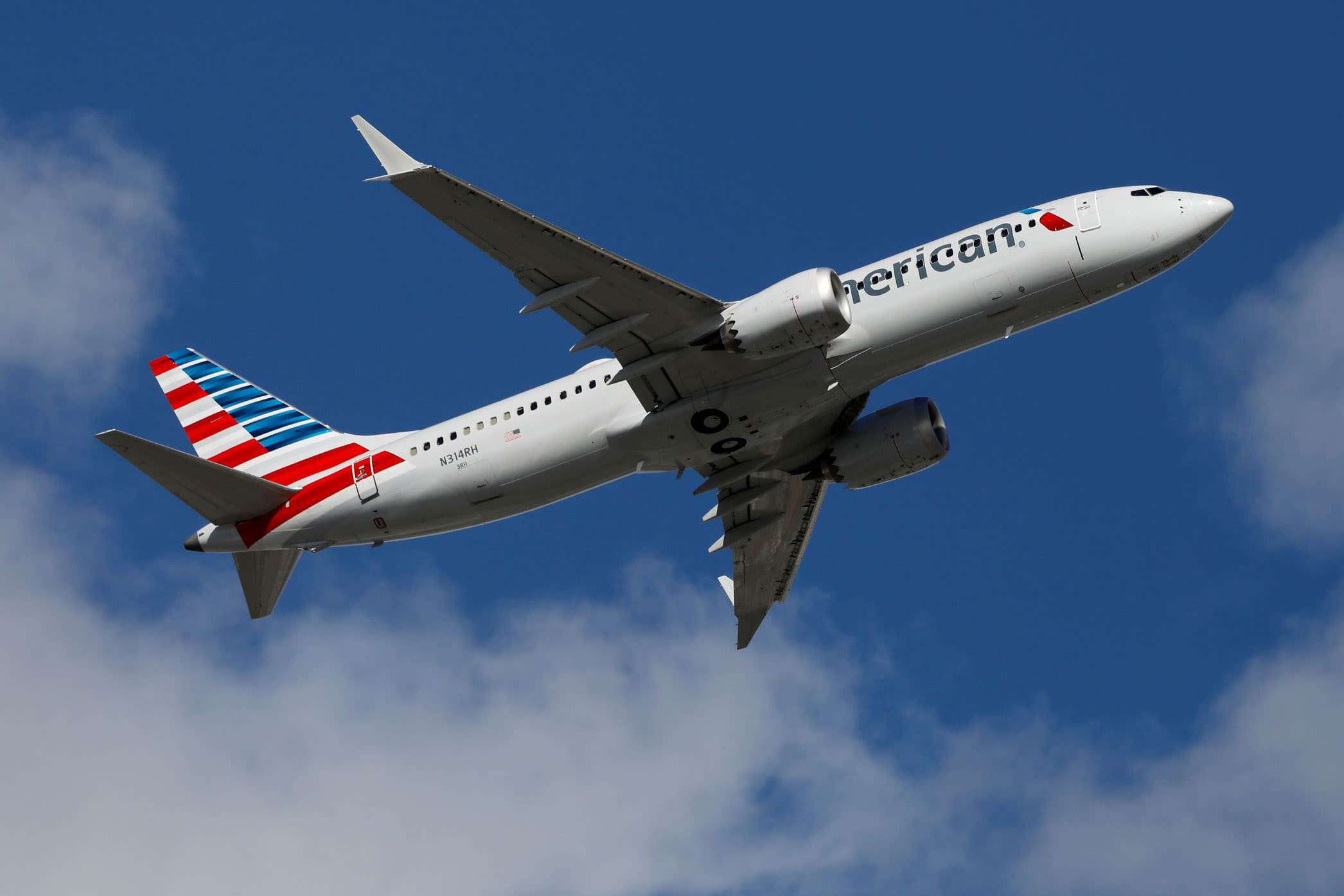 American Airlines expects to fly less than half of 2019 schedule through February as virus spreads – CNBC
