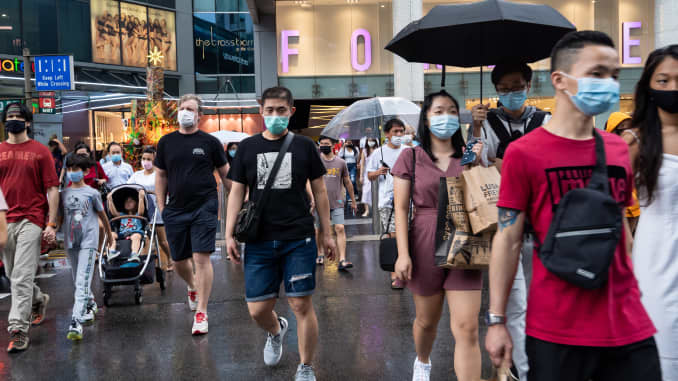 Crowds, in the hundreds, thronged Singapore's shopping belt in preparation for the festive season despite the coronavirus (Covid-19) pandemic which has recorded a total of over 58,000 confirmed cases and 29 related deaths in Singapore on December 12, 2020