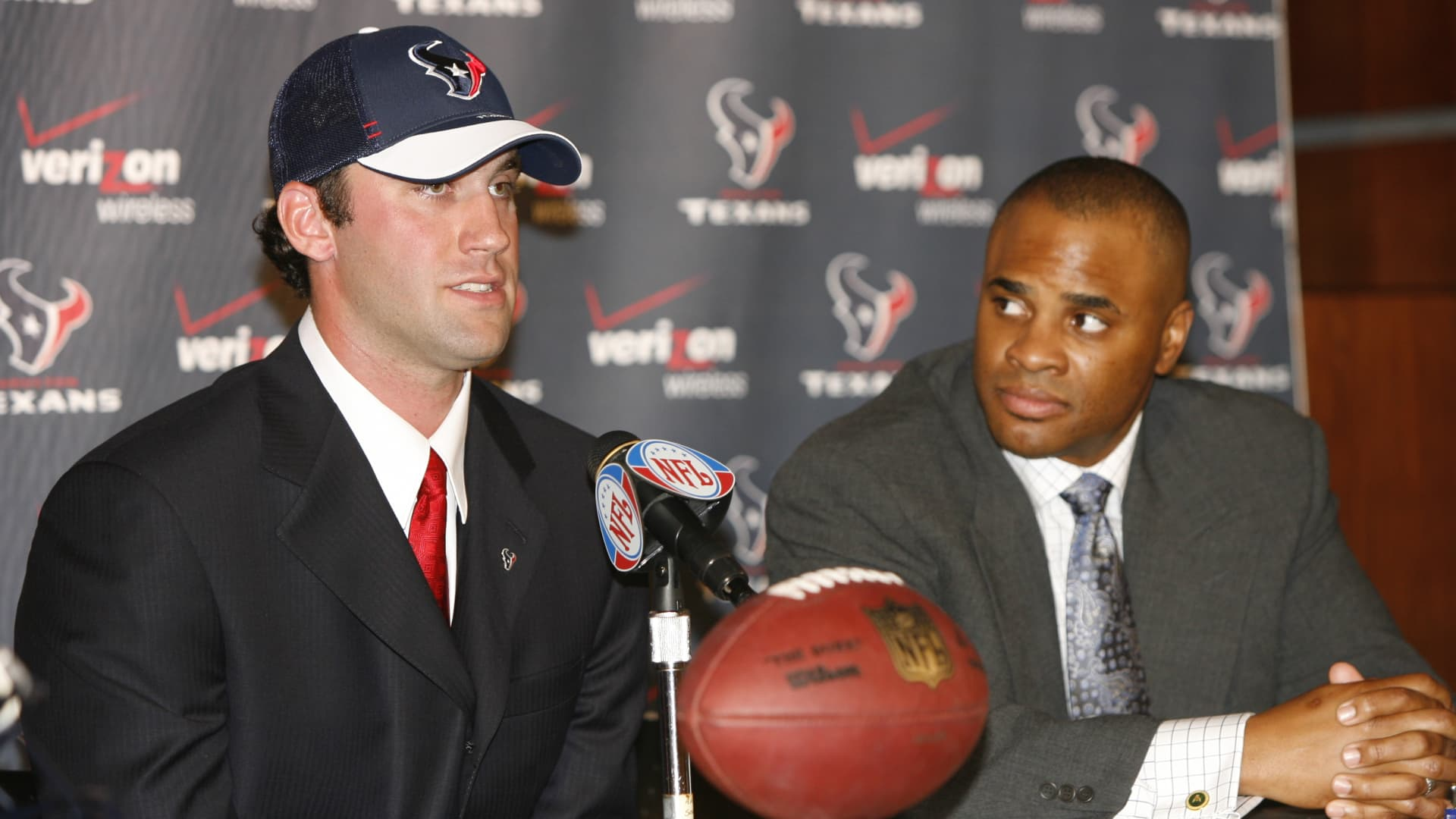 Houston Texans Matt Schaub (L) speaks to the media as Texans GM Rick Smith looks on during the press conference to introduce him as the Texans new starting quarterback after trading with the Atlanta Falcons on March 22, 2007 in Houston, Texas.