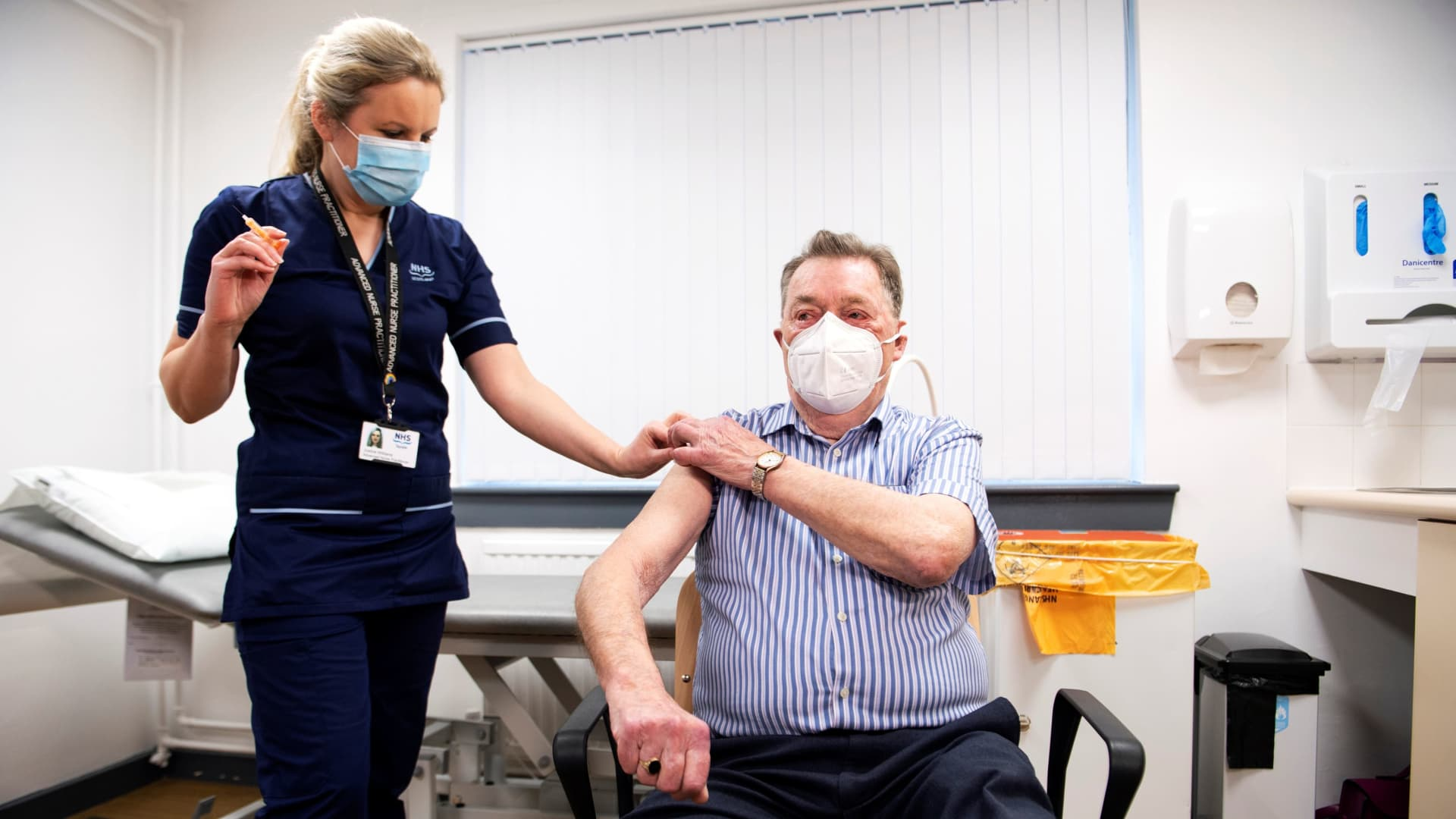 James Shaw, 82, receives the Oxford University/AstraZeneca COVID-19 vaccine from advanced nurse practitioner Justine Williams, at the Lochee Health Centre in Dundee, Scotland, Britain January 4, 2021.