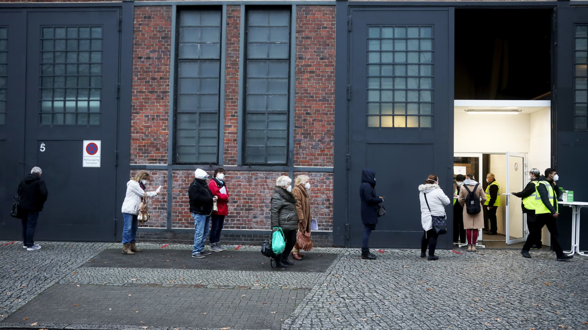 Visitors queue outside a Covid-19 vaccination site at Berlin Arena in Berlin, Germany.