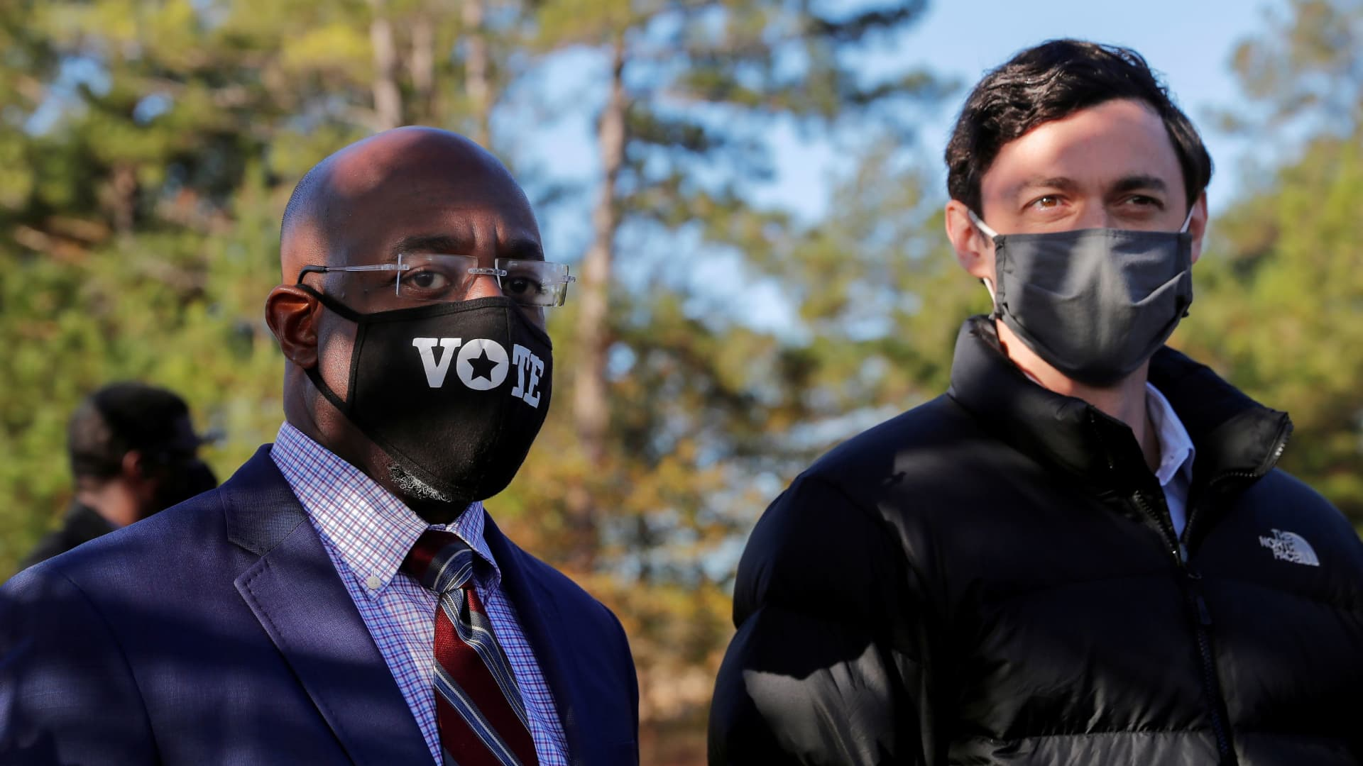 Democratic U.S. Senate candidates Jon Ossoff and Rev. Raphael Warnock look on as they appear together at a campaign rally ahead of U.S. Senate runoff elections in Augusta, Georgia, U.S. January 4, 2021.