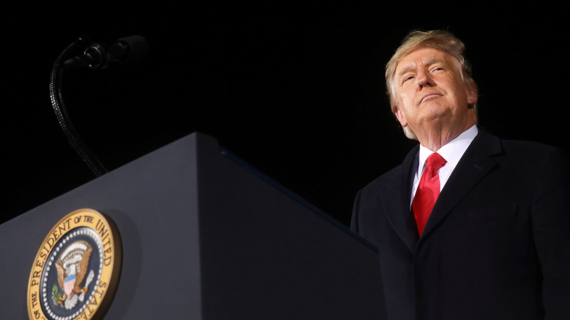 U.S. President Donald Trump addresses a campaign rally in Dalton, Georgia, U.S., on the eve of the run-off election to decide both of Georgia's Senate seats January 4, 2021.