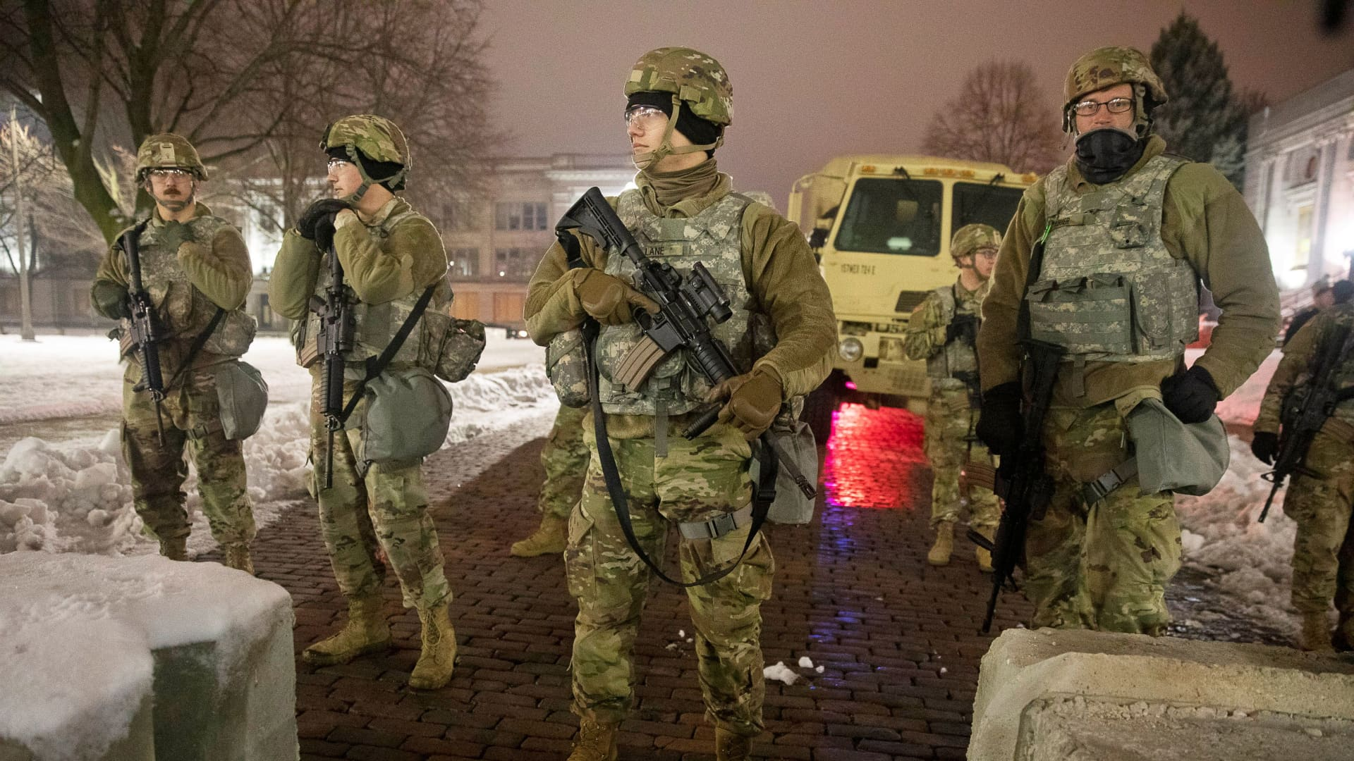 Members of the National Guard stand guard near the Kenosha, Wisconsin, county courthouse on January 5, 2021, after the prosecutor announced no charges would be filed in the wounding of Jacob Blake, a Black man left paralyzed in an August 2020 police shooting.