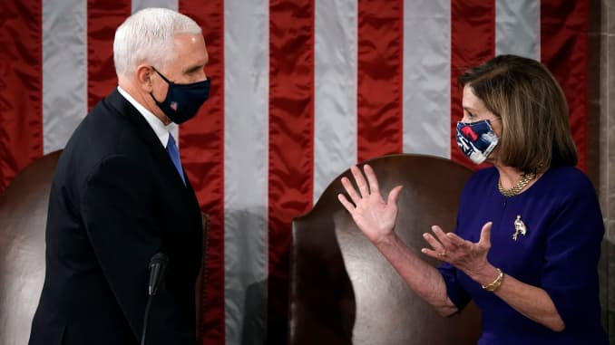 Speaker of the House Nancy Pelosi, D-CA, and Vice President Mike Pence officiate as a joint session of the House and Senate convenes to count the Electoral College votes cast in November's election, at the Capitol in Washington,DC on January 6, 2021.