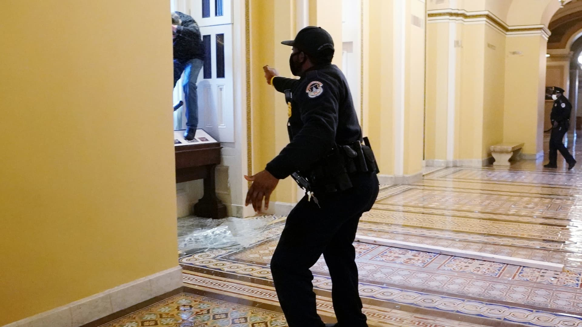 A U.S. Capitol police officer shoots pepper spray at a protestor attempting to enter the Capitol building during a joint session of Congress to certify the 2020 election results on Capitol Hill in Washington, January 6, 2021.