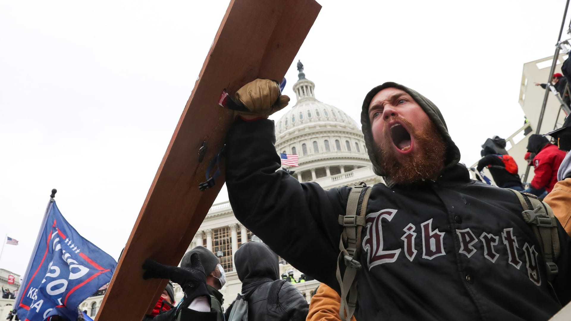A man shouts as supporters of U.S. President Donald Trump gather in front of the U.S. Capitol Building in Washington, January 6, 2021.
