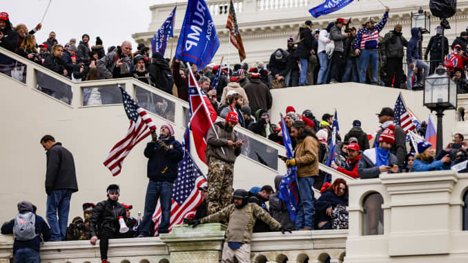 Photos show violent clashes as Trump supporters storm the U.S. Capitol