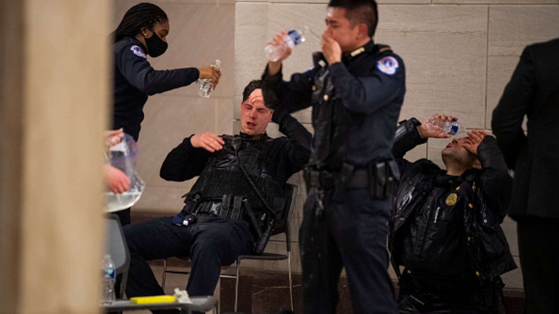 Capitol Police officers receive medical treatment after clashes with protesters attempting to disrupt the joint session of Congress to certify the Electoral College vote on Wednesday, January 6, 2021.