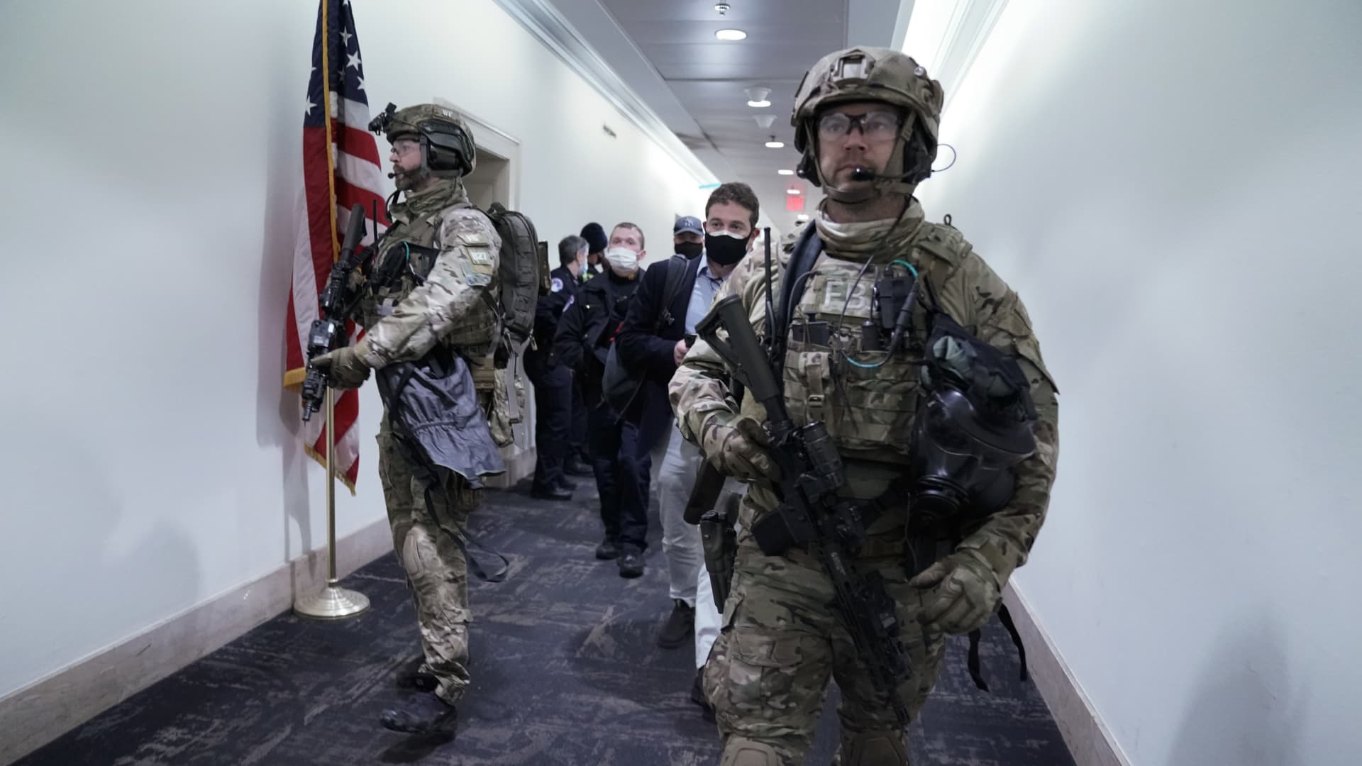 Members of the Federal Bureau of Investigation (FBI) swat team patrol the Longworth House Office building after a joint session of Congress to count the votes of the 2020 presidential election took place in Washington, D.C., U.S., on Wednesday, Jan. 6, 2021.