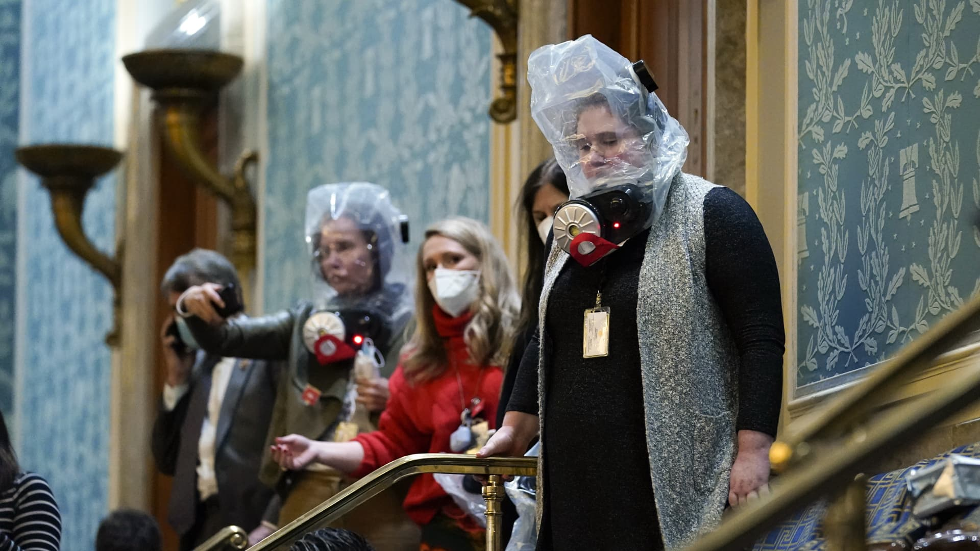People are seen in the House gallery as protesters try to break into the House Chamber at the U.S. Capitol on Wednesday, Jan. 6, 2021, in Washington.