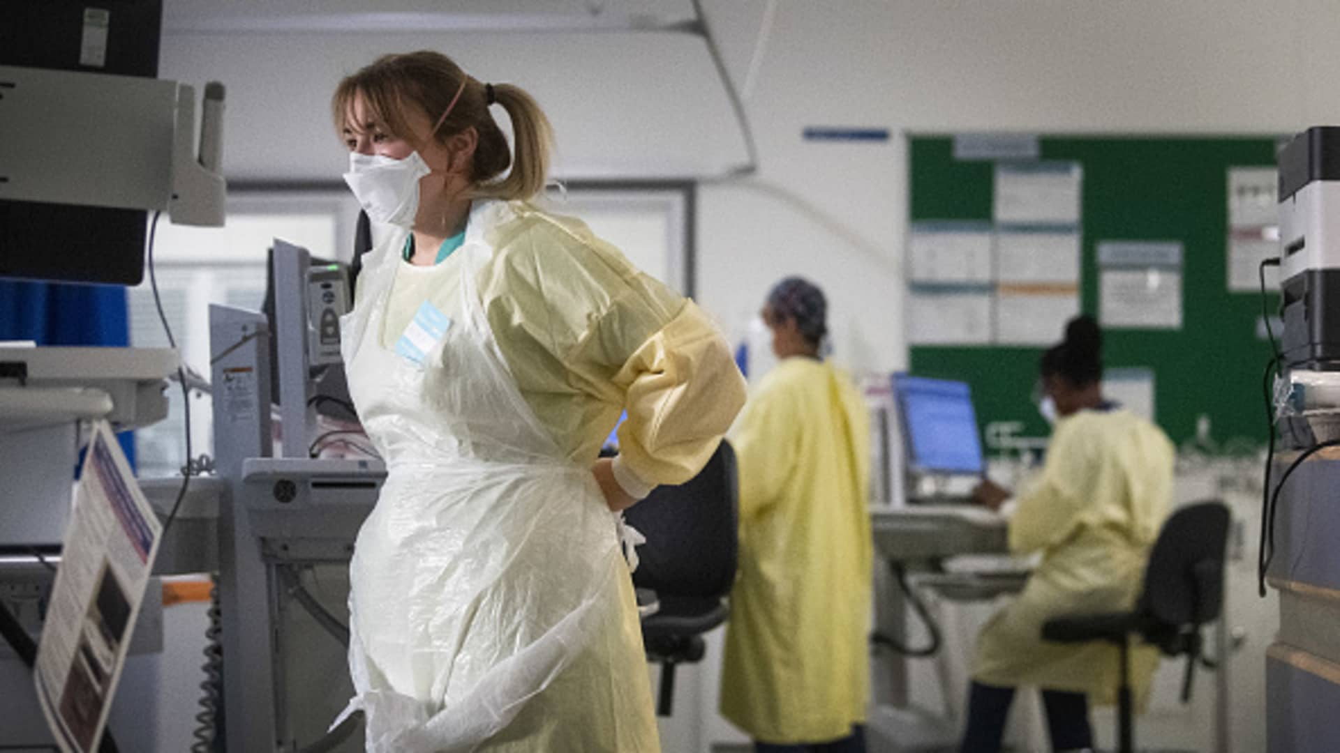 A nurse adjusts her PPE in the ICU (Intensive Care Unit) in St George's Hospital in Tooting, south-west London, where the number of intensive care beds for the critically sick has had to be increased from 60 to 120, the vast majority of which are for coronavirus patients.