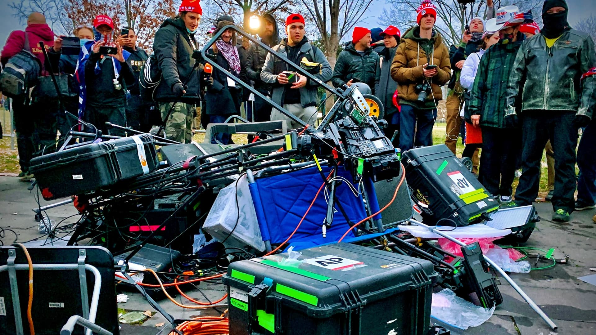 Supporters of US President Donald Trump stand next to media equipment they destroyed during a protest on JAnuary 6, 2020 outside the Capitol in Washington, DC.