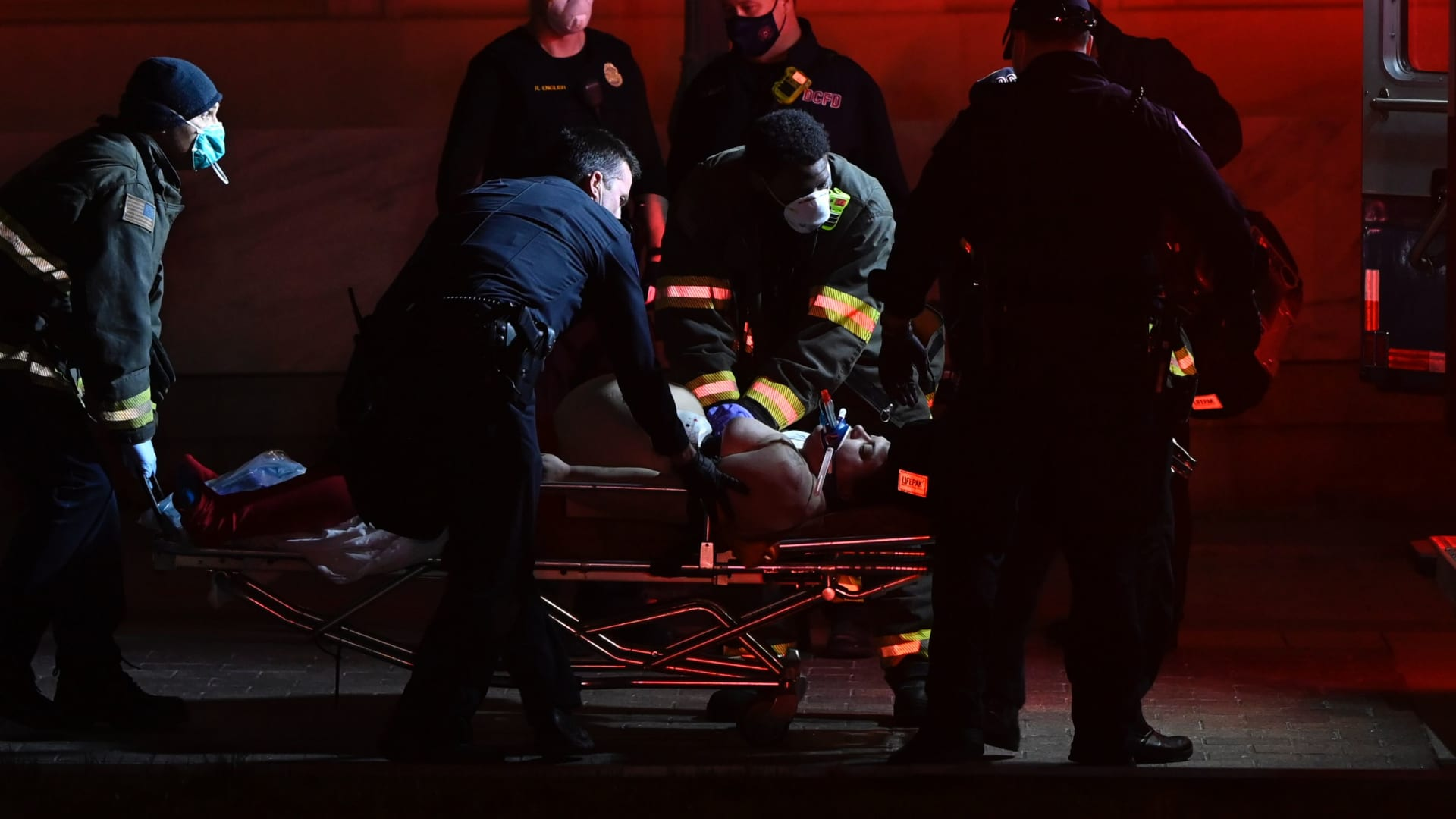 Paramedics perform cardiopulmonary resuscitation on a patient on January 6, 2021, in Washington, DC.