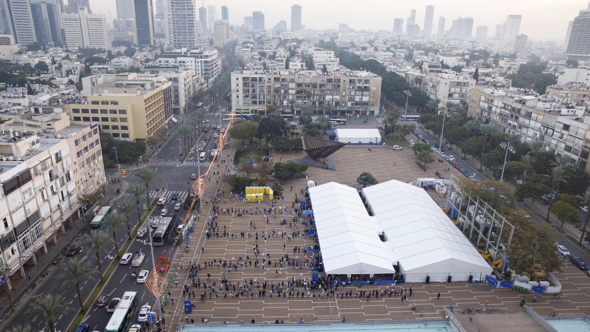 People queue outside a Covid-19 mass vaccination center at Rabin Sqaure in this aerial photograph taken in Tel Aviv, Israel, on Monday, Jan. 4, 2020. Israel plans to vaccinate 70% to 80% of its population by April or May, Health Minister Yuli Edelstein has said.