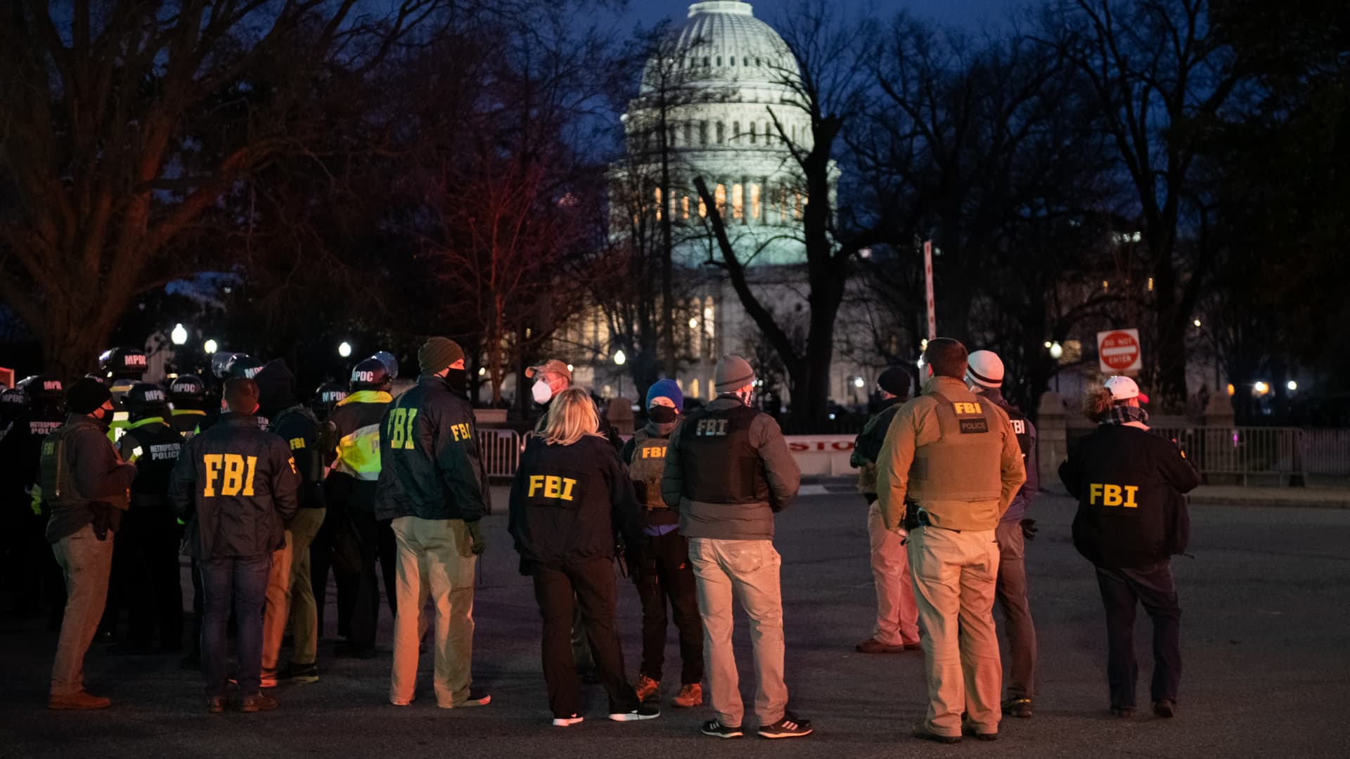 Federal Bureau of Investigation (FBI) agents arrive at Capitol Hill in Washington, D.C., U.S., on Jan. 6, 2021.
