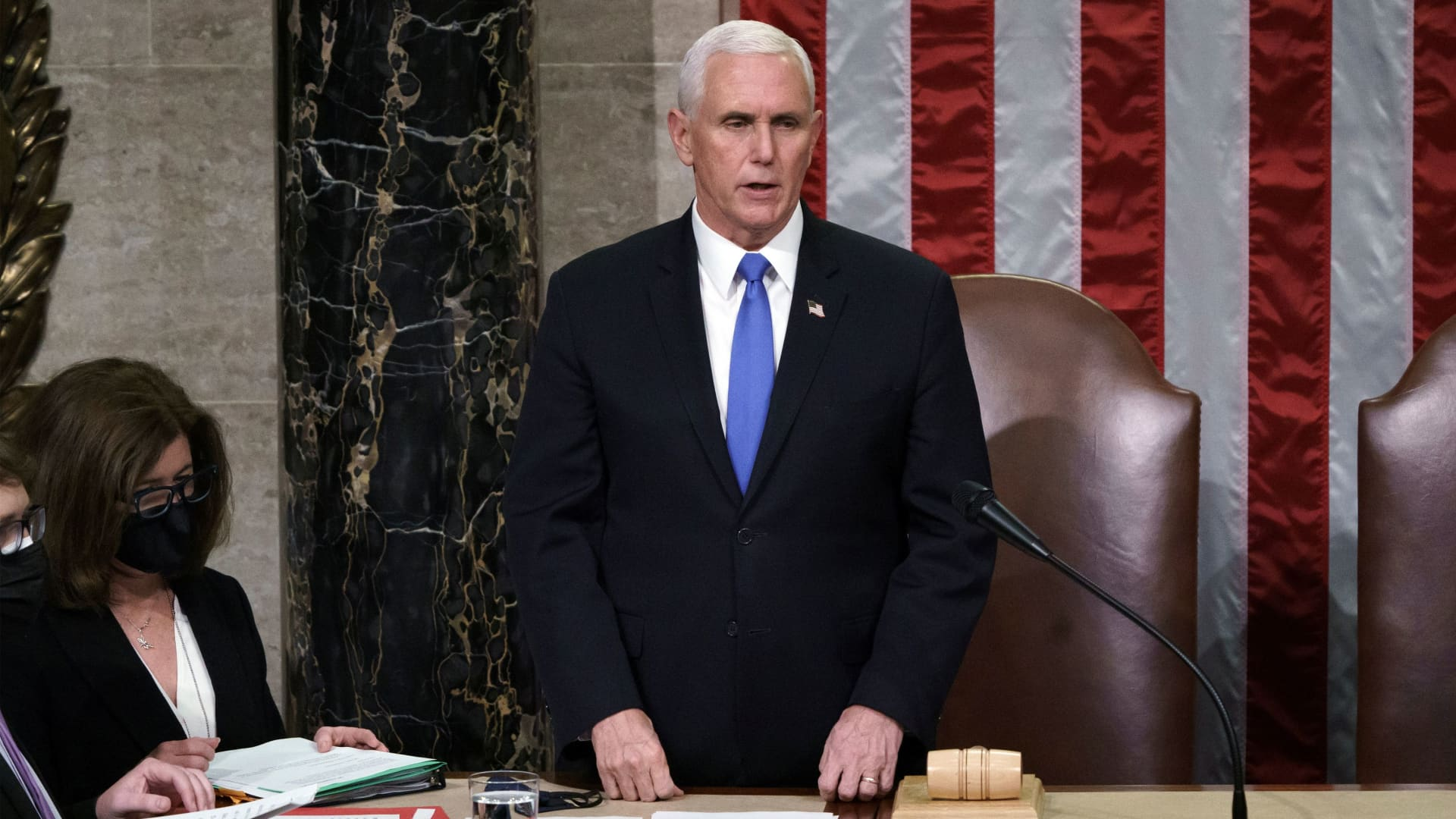 U.S. Vice President Mike Pence reads the final certification of Electoral College votes cast in November's presidential election during a joint session of Congress after working through the night, at the Capitol in Washington, January 7, 2021.