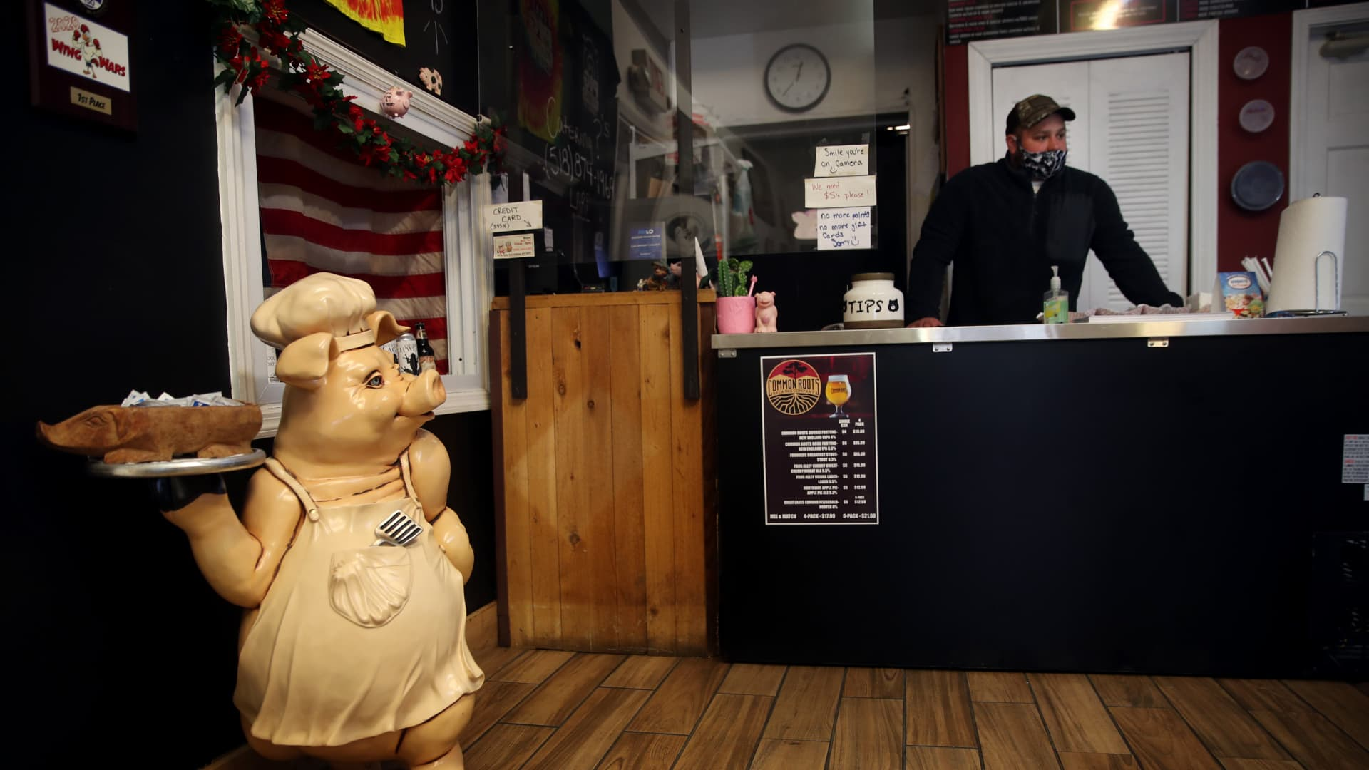 Manager Pat Ryan stands at the counter at the Pig Pit BBQ in Cohoes, NY on December 09, 2020. The pandemic crushed businesses on Boston's Water Street.