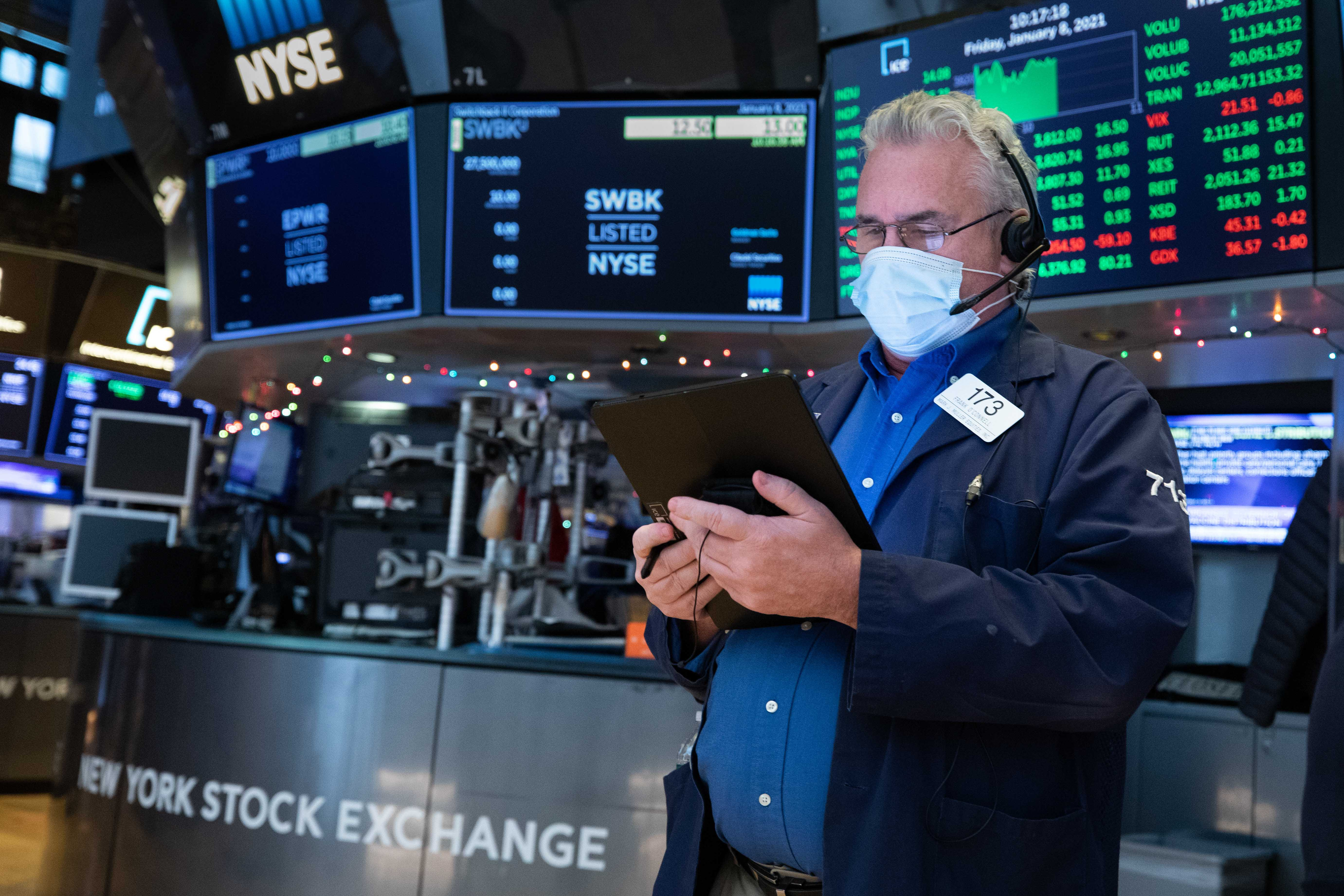 U.S. stock futures rose on Wednesday night as traders kept an eye on interest rates and lingering turmoil in Washington.