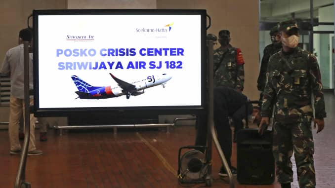 Indonesian soldiers stand near a crisis center set up following a report that a Sriwijaya Air passenger jet has lost contact with air traffic controllers after take off, at Soekarno-Hatta International Airport in Tangerang, Indonesia, Saturday, Jan. 9, 20