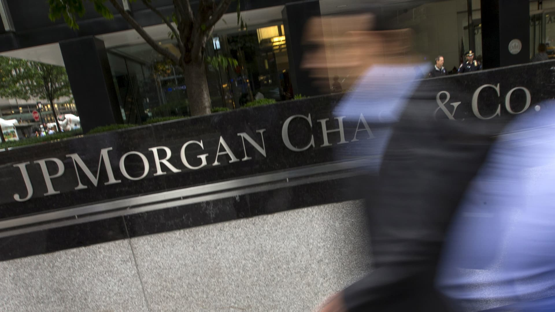 People pass the JP Morgan Chase & Co. Corporate headquarters in the Manhattan borough of New York City.