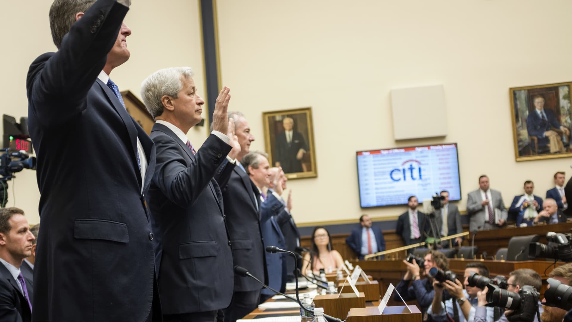 (L to R) Michael Corbat, CEO of Citigroup, Jamie Dimon, CEO of JP Morgan Chase, James Gorman, CEO of Morgan Stanley, Brian Moynihan, CEO of Bank of America, Ronald OHanley, CEO of State Street Corporation, Charles Scharf, CEO of Bank of New York Mellon, and David Solomon, CEO of Goldman Sachs are sworn in to testify before the House Financial Services Commitee in Washington Wednesday April 10, 2019.