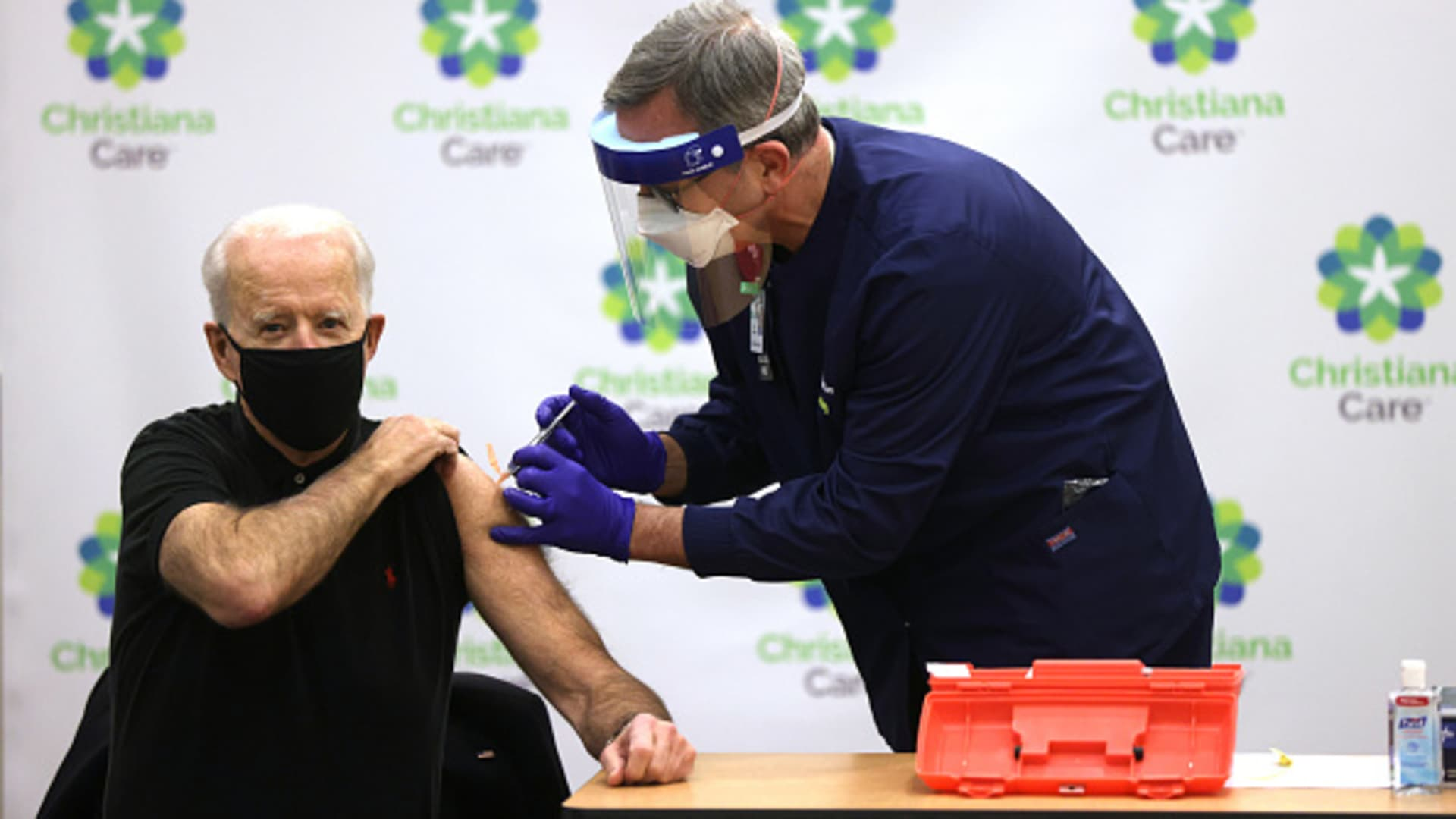 President-elect Joe Biden (L) receives the second dose of a COVID-19 Vaccination from Chief Nurse Executive Ric Cuming (R) at ChristianaCare Christiana Hospital on January 11, 2021 in Newark, Delaware.