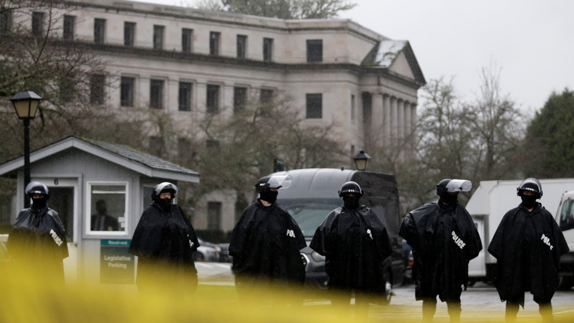 Members of the Washington State Patrol stand guard outside the Washington State Capitol Building as the 2021 Legislative session begins in Olympia, Washington, January 11, 2021.