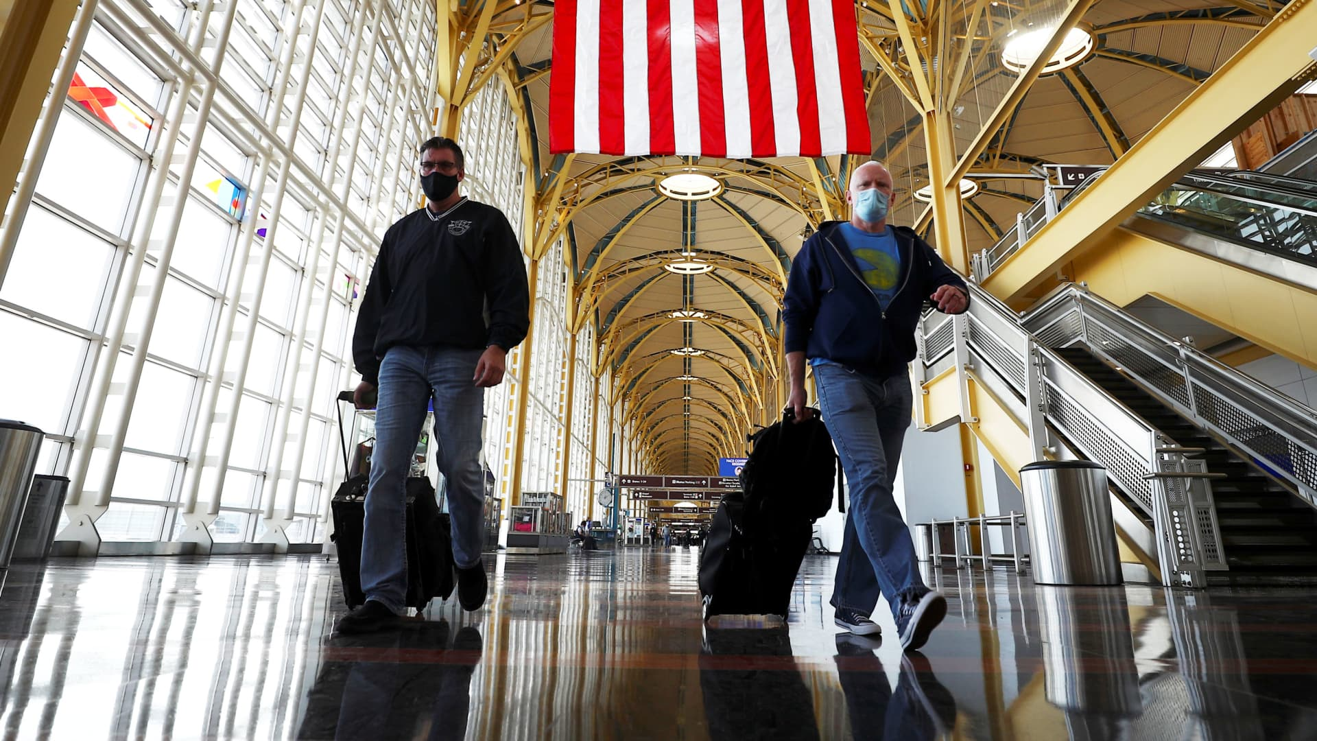 People walk at Reagan National Airport in Arlington, Virginia.