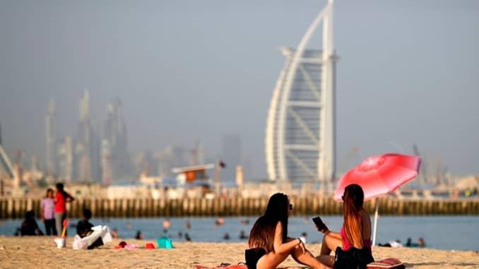 Beachgoers at a Dubai beach as the UAE emirate reopens for tourism amid the coronavirus pandemic.
