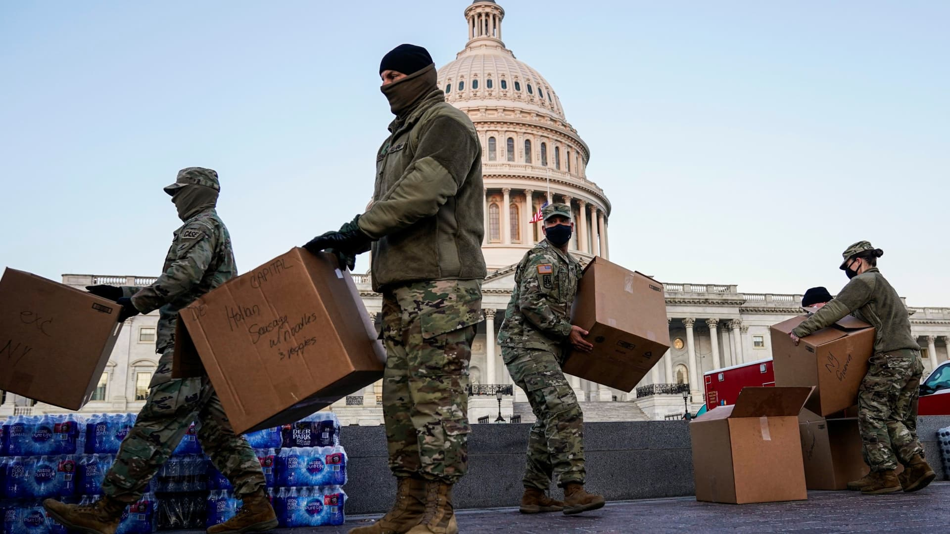 Members of the National Guard move boxes of food at the U.S. Capitol as Democratic members of the House prepare an article of impeachment against U.S. President Donald Trump in Washington, U.S., January 12, 2021.