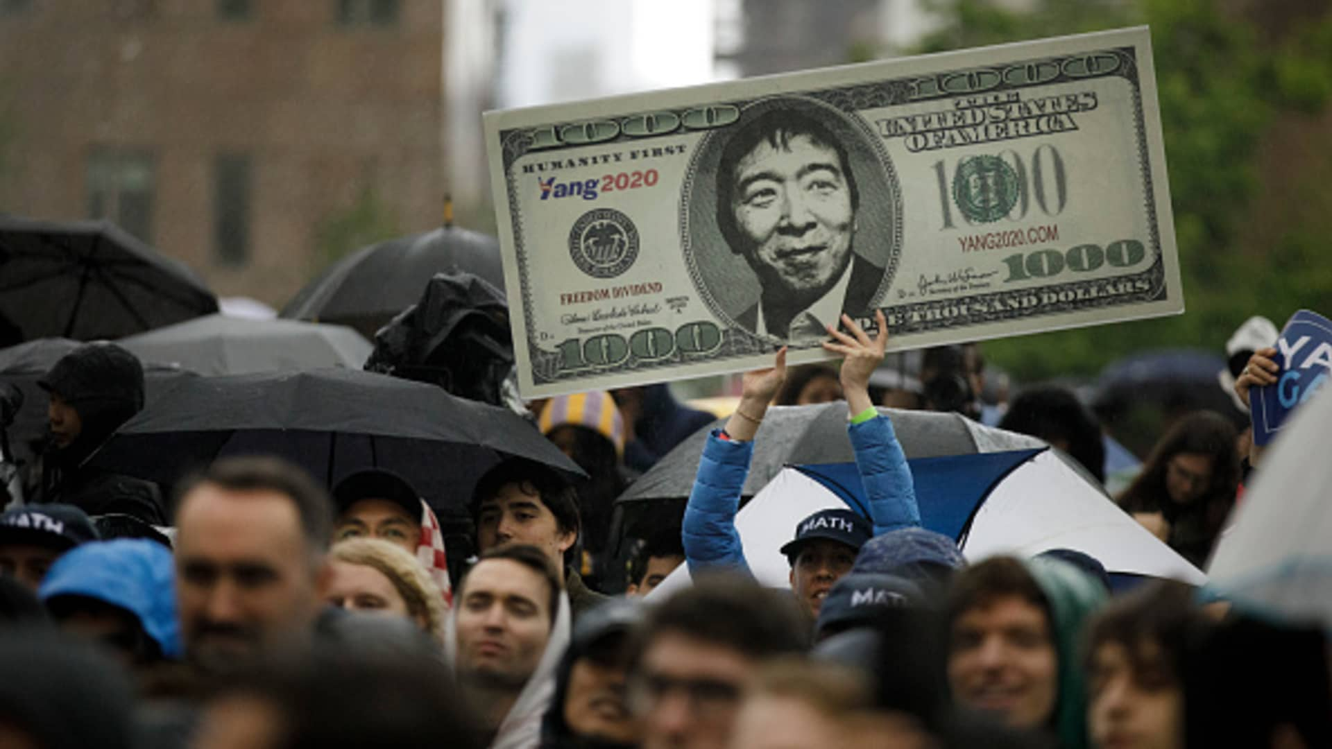 A sign supporting Democratic presidential candidate Andrew Yang's plan for a $1,000 monthly universal basic income at a May 14, 2019, rally in New York.