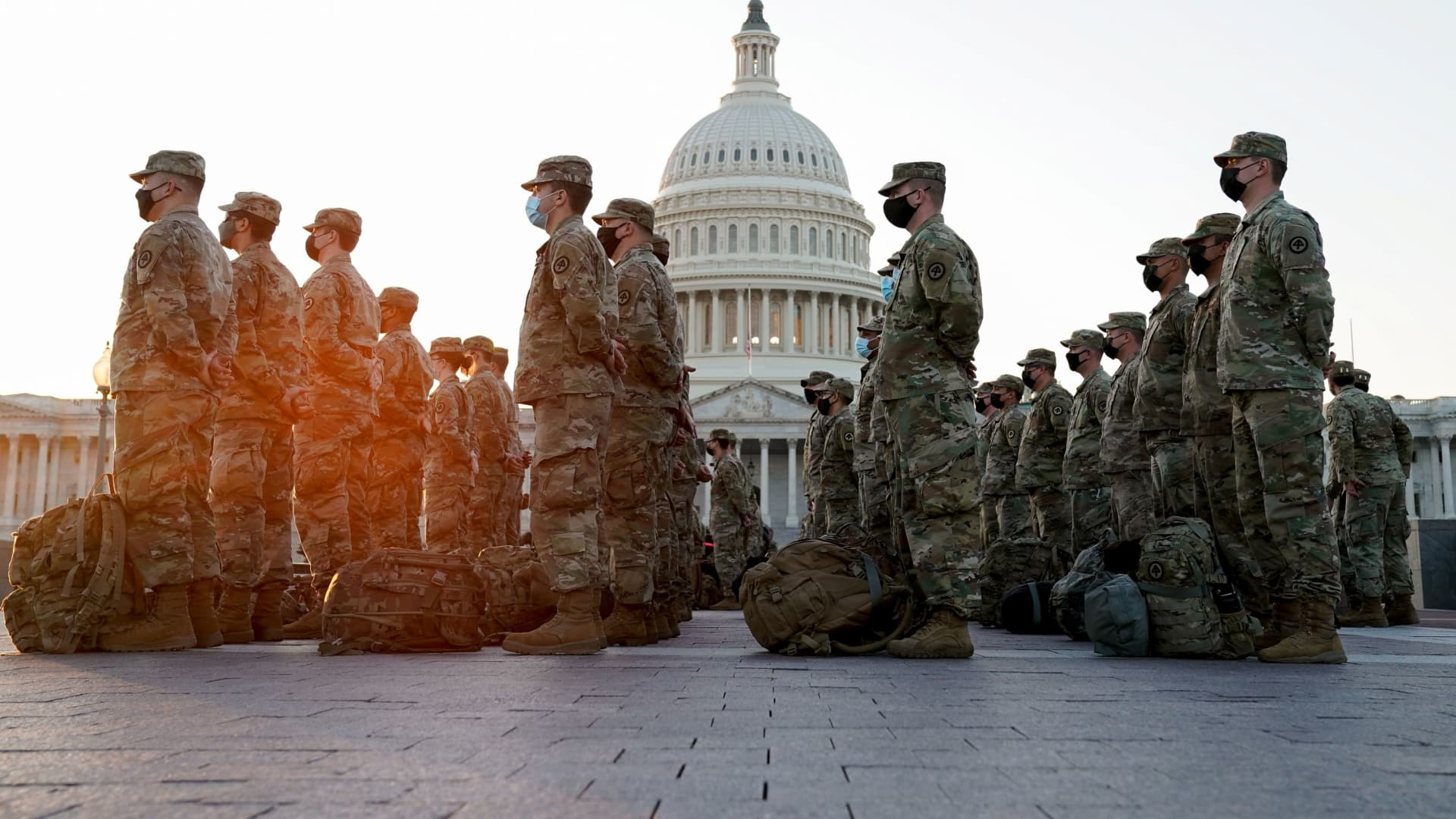 Members of the National Guard gather at the U.S. Capitol as the House of Representatives prepares to begin the voting process on a resolution demanding U.S. Vice President Pence and the cabinet remove President Trump from office, in Washington, January 12, 2021.