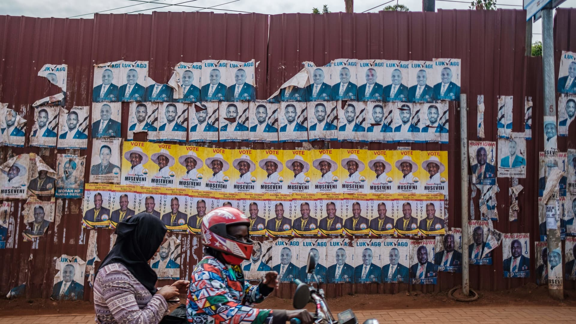 Posters of the two most popular candidates for Uganda's Presidential election, incumbent President Yoweri Museveni (yellow) and Robert Kyagulanyi, aka Bobi Wine, the pop star-turned-opposition leader, are seen along a street in Kampala, Uganda, on January 6, 2021.