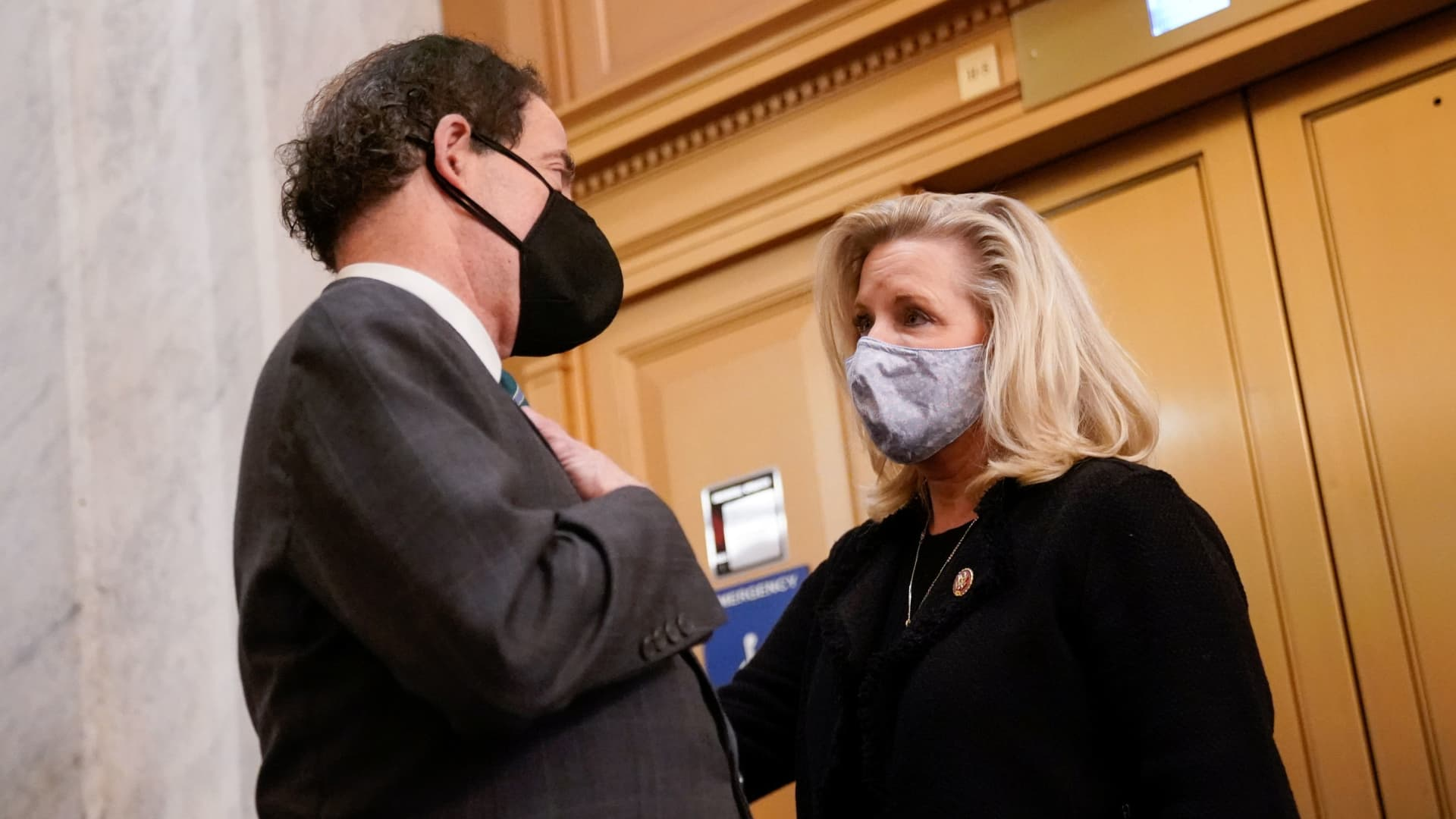Rep. Jamie Raskin (D-MD) talks with Rep. Liz Cheney (R-WY) in the U.S. Capitol after the House voted on a resolution demanding U.S. Vice President Pence and the cabinet remove President Trump from office, in Washington, U.S., January 12, 2021.