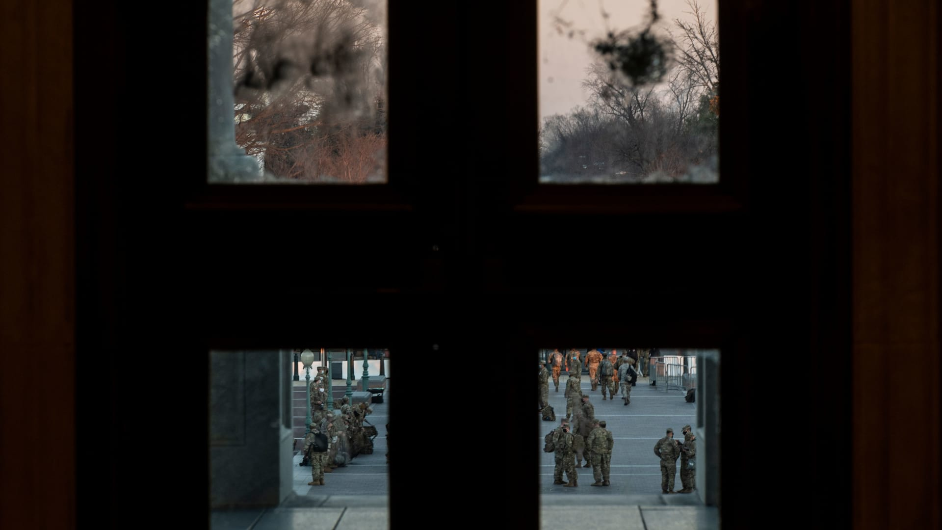Damage is seen on a door at the US Capitol, from the January 6 riots, as members of the US National Guard arrive outside on January 12, 2021 in Washington, DC.
