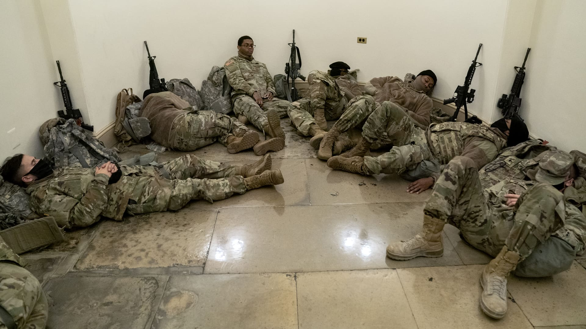 Members of the National Guard rest in the U.S. Capitol on January 13, 2021 in Washington, DC.