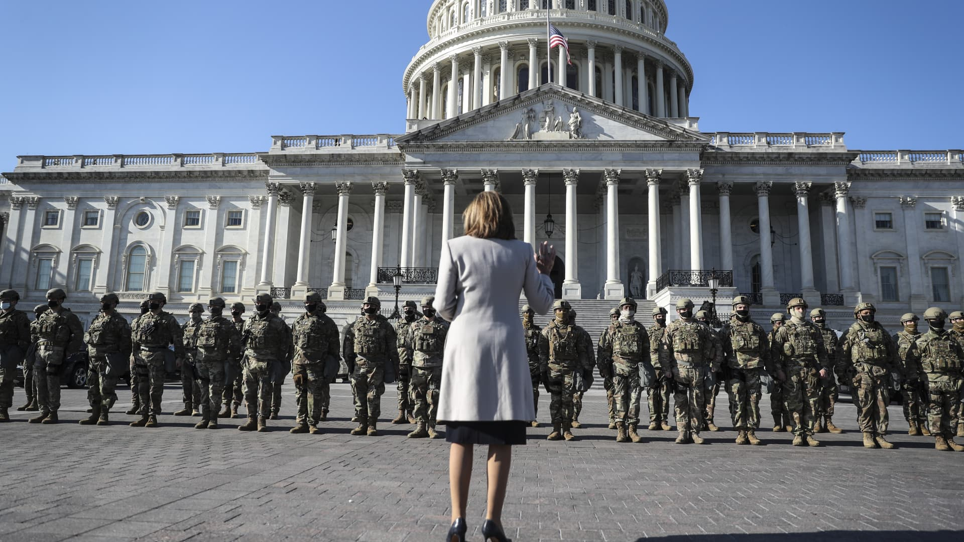 U.S. House Speaker Nancy Pelosi, D-Calif., stands in front of a National Guard troop as she speaks, on the East Entrance of the US Capitol in Washington, DC, on January 13, 2021.