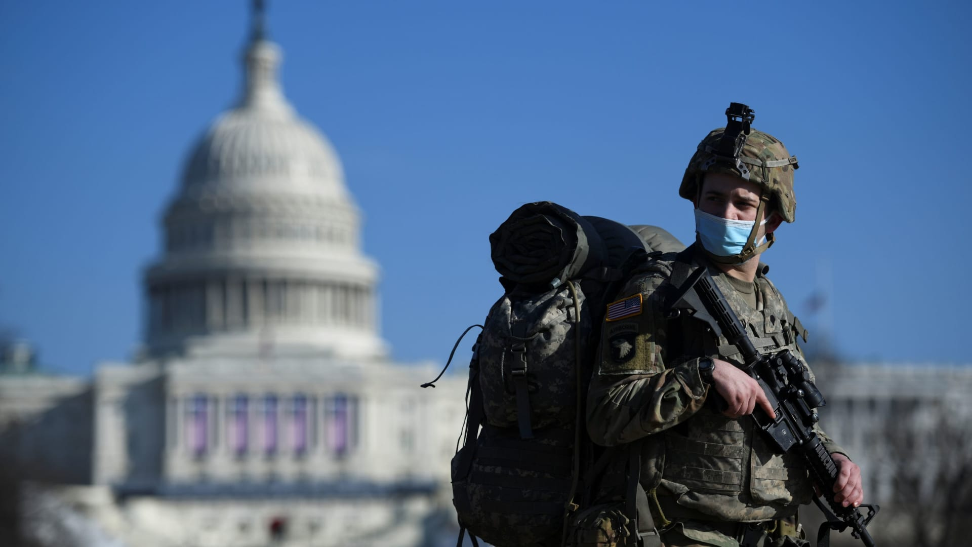 A member of the National Guard mounts guard near the U.S. Capitol building, as the House of Representatives debates impeaching U.S. President Donald Trump a week after his supporters stormed the Capitol building in Washington, U.S., January 13, 2021.