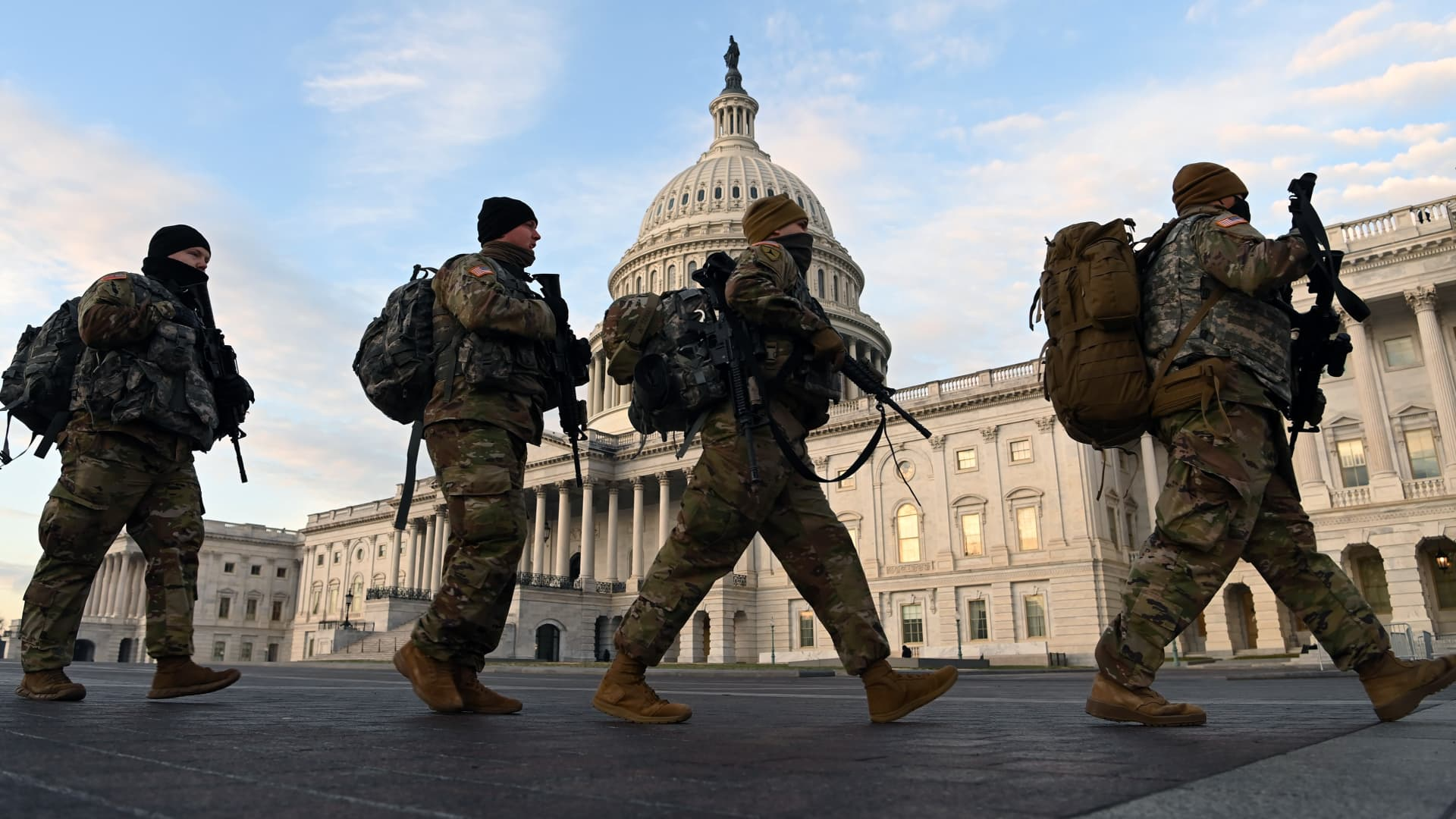 Members of the National Guard walk outside the United States Capitol on Thursday January 14, 2021 in Washington, DC.