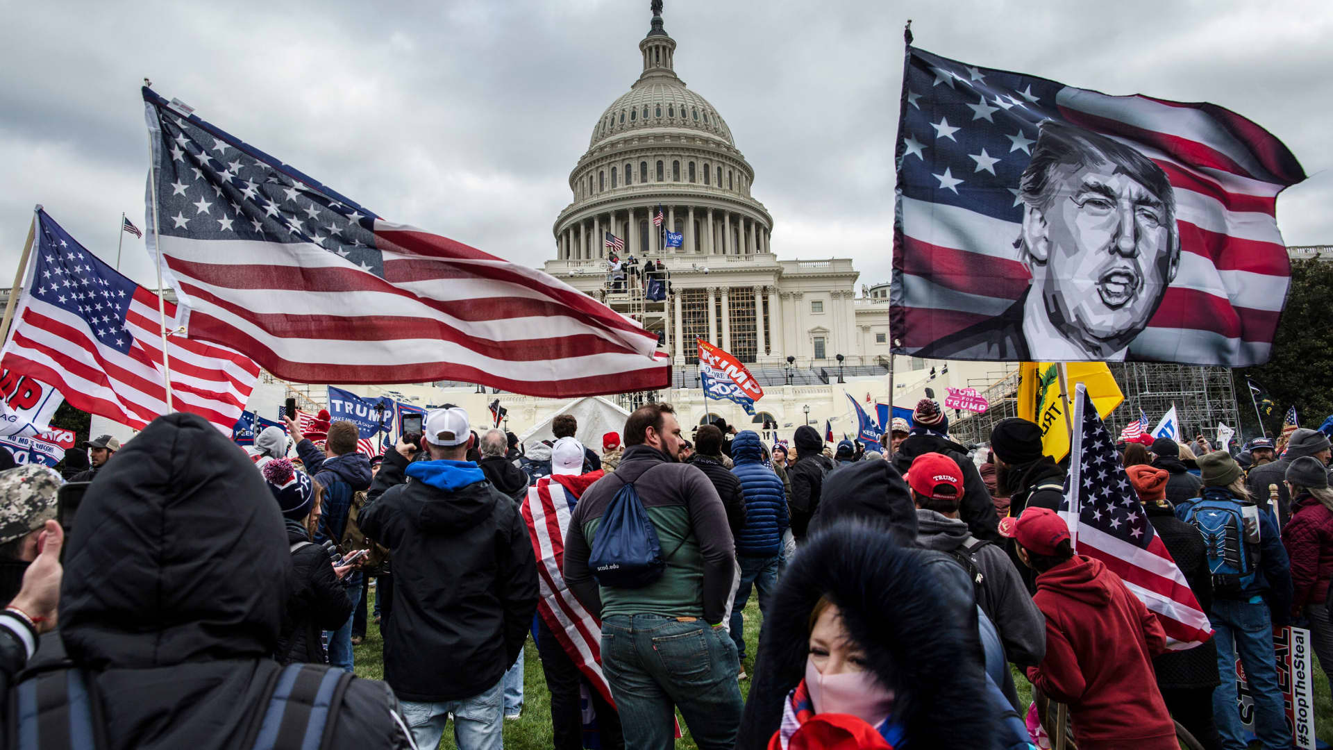 US President Donald Trump's supporters gather outside the Capitol building, January 6, 2021.