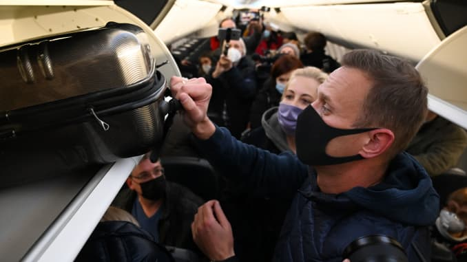 Russian opposition leader Alexei Navalny and his wife Yulia are seen in a Pobeda plane after it landed at Moscow's Sheremetyevo airport on January 17, 2021.