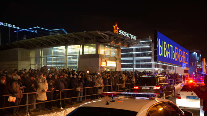 Crowds gather as they await the arrival of Alexey Navalny, Russian opposition leader, at Vnukovo International airport in Moscow, Russia, on Sunday, Jan. 17, 2021.