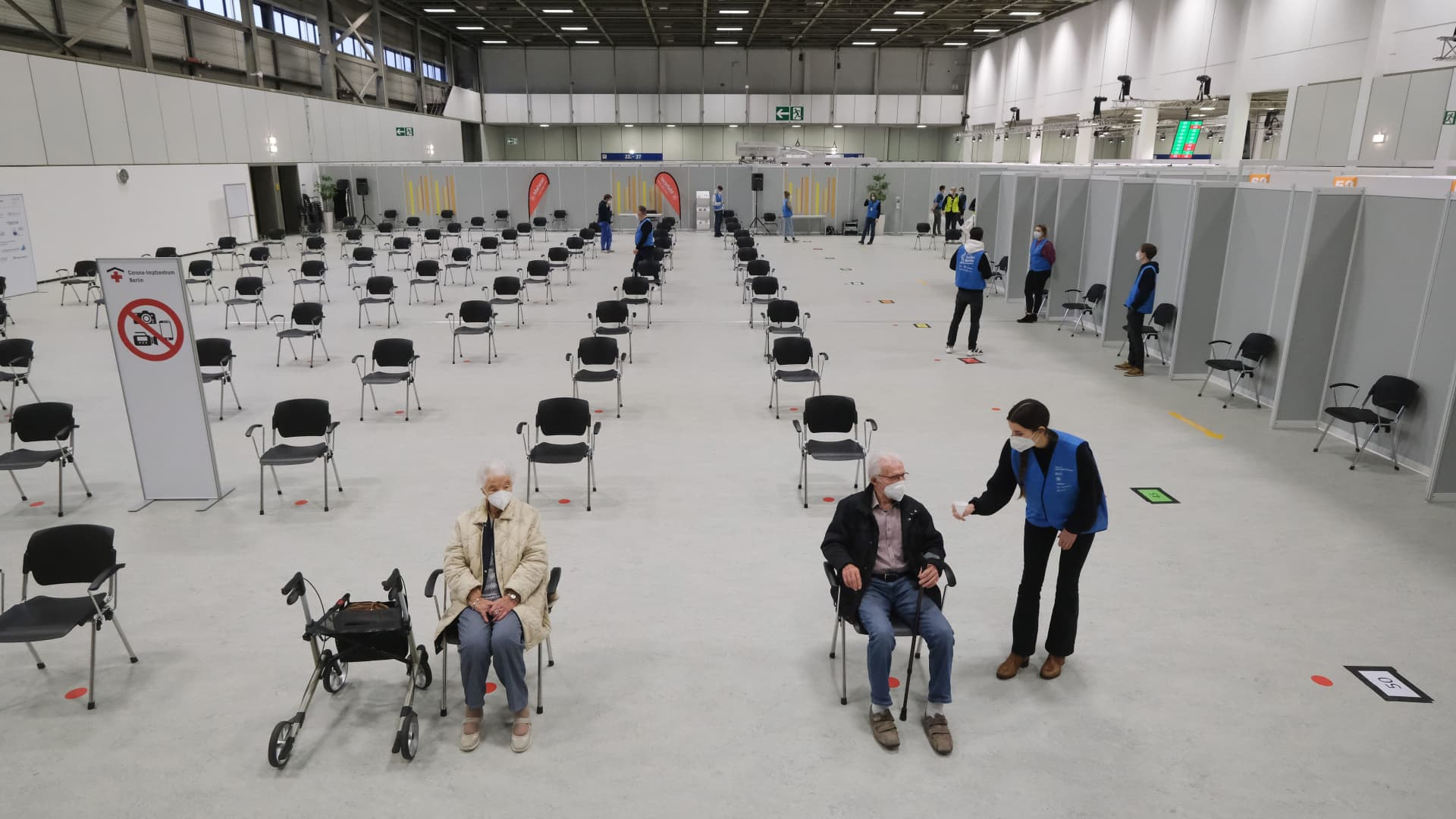Elderly people who had just been inoculated against COVID-19 wait briefly in case of side effects before departing at the vaccine center at the Messe Berlin trade fair grounds on the center's opening day during the second wave of the coronavirus pandemic on January 18, 2021 in Berlin, Germany. The center is the third to open in Berlin. Three more are to open in coming weeks once shipments of the Pfizer/BioNTech and Moderna vaccines pick up pace.