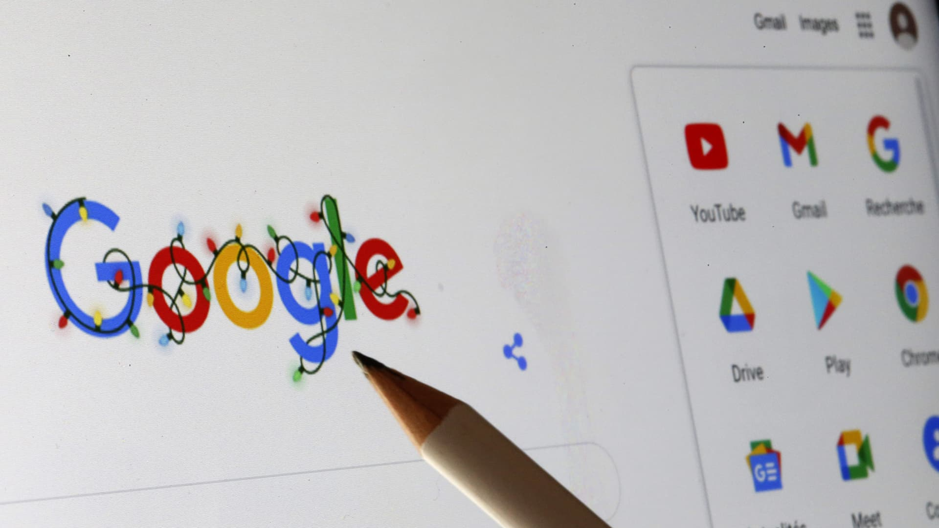 The logos of Google and several of its applications are displayed on a computer screen.