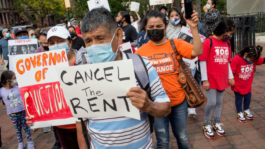 New York City housing advocates and tenants march to demand Gov. Andrew Cuomo cancel rent amid the pandemic on Oct. 10, 2020.