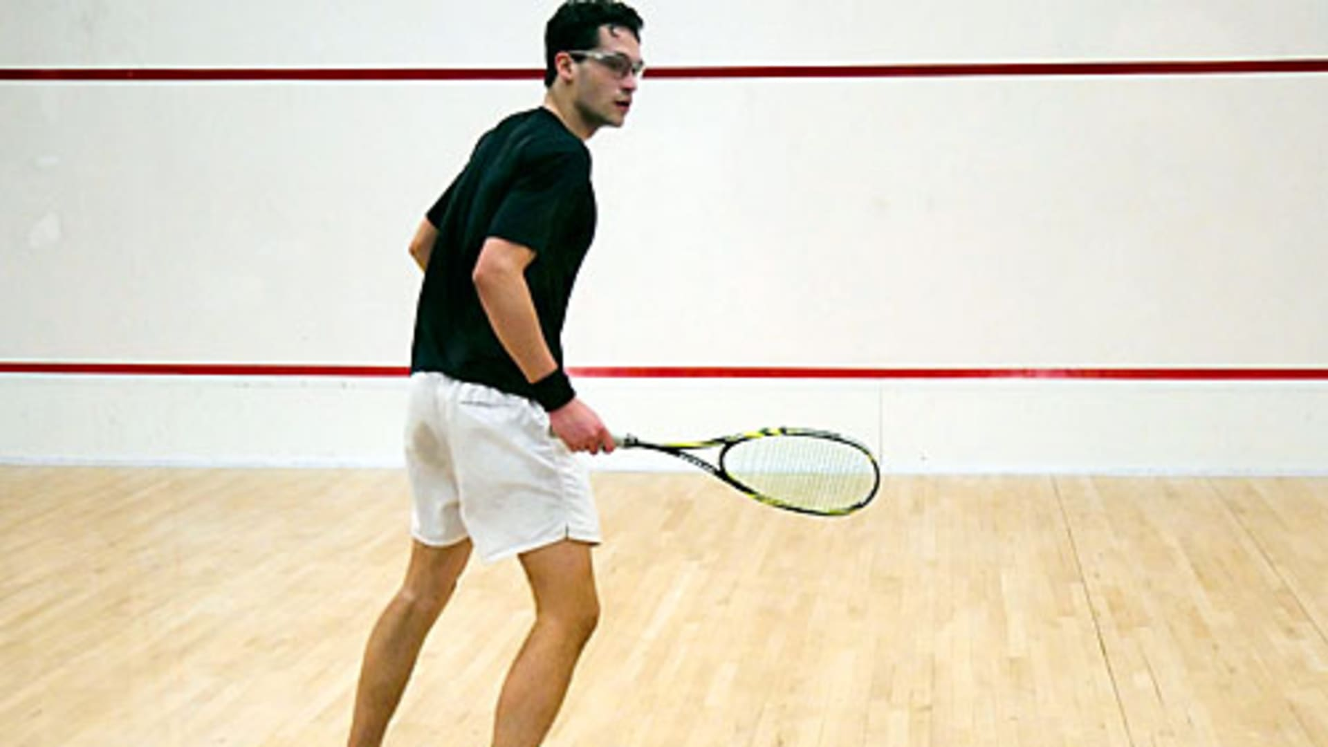 Will Ahmed playing squash at Harvard.
