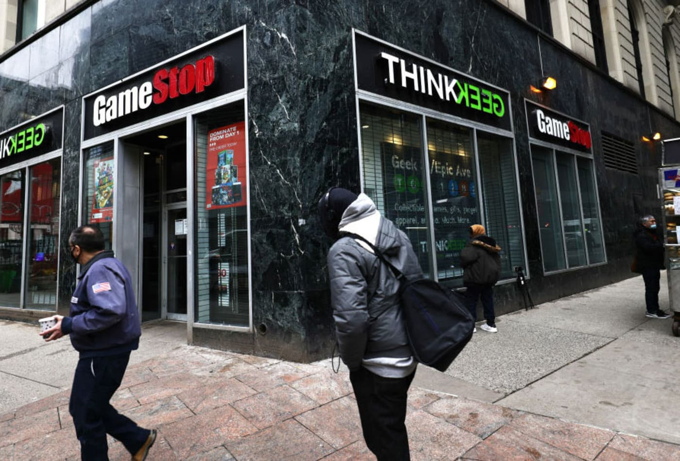 GameStop's stock closes down more than 40% after brokers place restrictions on trades