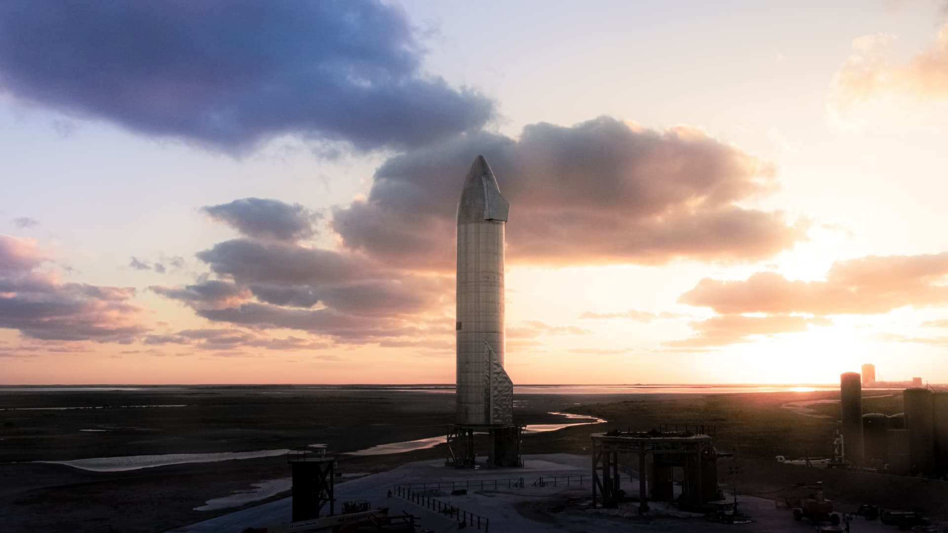 Starship prototype SN9 stands on the launchpad at sunset at SpaceX's development facility in Boca Chica, Texas.